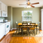 The bright full kitchen and dining area is the perfect place to have a meal